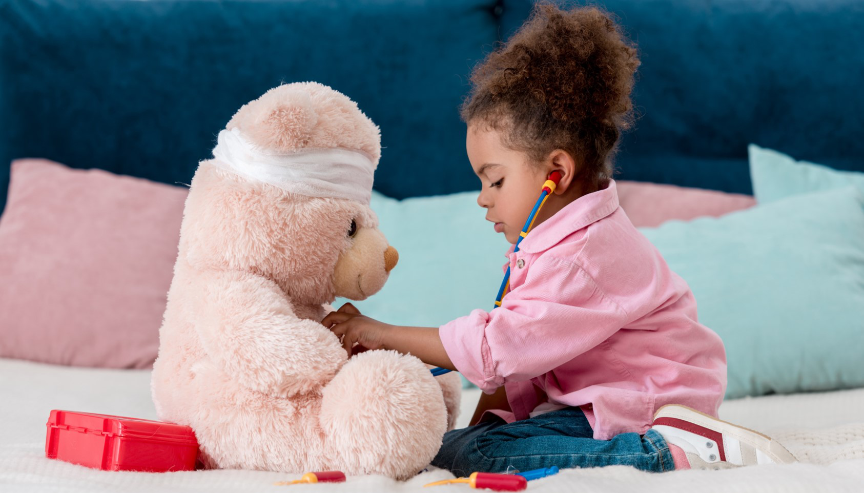Child playing hospitals with her teddy