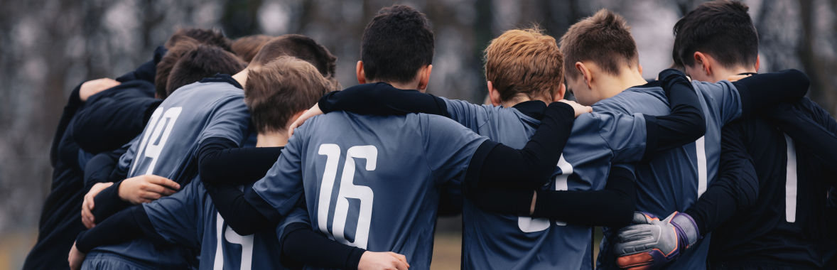 Young people in a football huddle