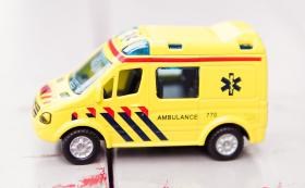 yellow toy ambulance on floor